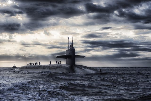 Submarine at sea, with sailors topside