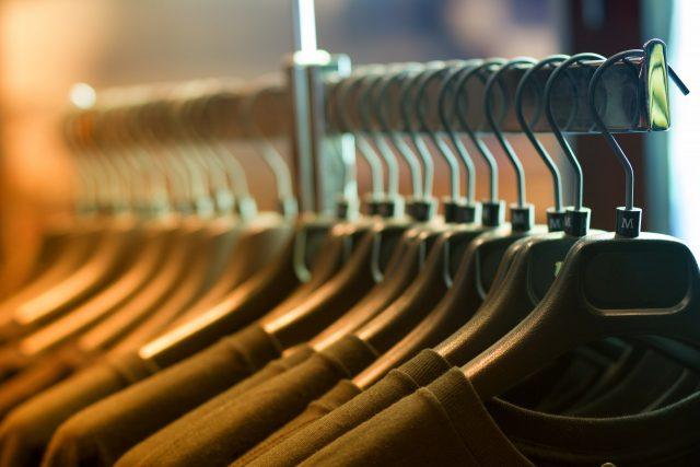 Pile of Shirts Hanged in Shirt Rack